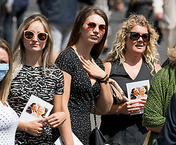 © Licensed to London News Pictures. 10/07/2020. London, UK. A group of women hold copies of the order of service with a picture of Dame Vera Lynn on the cover, as members of the public gather in the town of Ditchling, East Sussex, to pay their respects ahead of the funeral of Dame Vera Lynn. The 'Forces' Sweetheart', who died last month aged 103, was famous for singing performances during WW2, which helped raise morale amongst troops abroad. Photo credit: Ben Cawthra/LNP