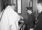 Garda Siochana Diamond Jubilee..1982.21.02,1982.02.21.1982.21st February 1982..One of the co-celebrants accepts the gifts from two members of the force, a Garda and Bangarda.
