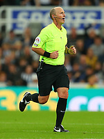 NEWCASTLE UPON TYNE, ENGLAND - SEPTEMBER 17: the referee, Mike Dean, during the Premier League match between Newcastle United and Leeds United at St. James Park on September 17, 2021 in Newcastle upon Tyne, England. (Photo by MB Media)