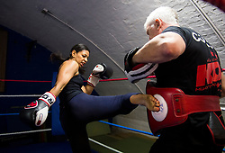 © London News Pictures. 10/09/2015. British Bangladeshi Female Boxer Ruqsana Begum, pictured at KO Muay Thai Gym in east London. Ruqsana is current British female Atomweight Muay Thai boxing champion and captain of the British Muay Thai Team. Photo credit: Ben Cawthra/LNP
