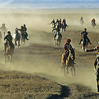 MONGOLIA. Youngsters gallop bare-back in a Naadum festival race near Rinchenlhumbe in the Darhad Valley.
