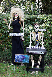 30 October 2015. New Orleans, Louisiana.<br /> The Skeleton Krewe mansion on St Charles Avenue at the corner of State Street draws crowds with its satirically spooky Halloween decorations. Singer and American Idol judges Carrie Underwood is depicted as 'Scarrie Underwood,' whilst Harry Connick is depicted as 'Scarry Connick.' <br /> Photo©; Charlie Varley/varleypix.com