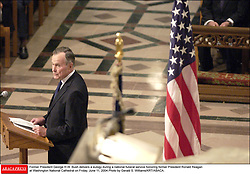 Former President George H.W. Bush delivers a eulogy during a national funeral service honoring former President Ronald Reagan at Washington National Cathedral on Friday, June 11, 2004.Photo by Gerald S. Williams/KRT/ABACA.