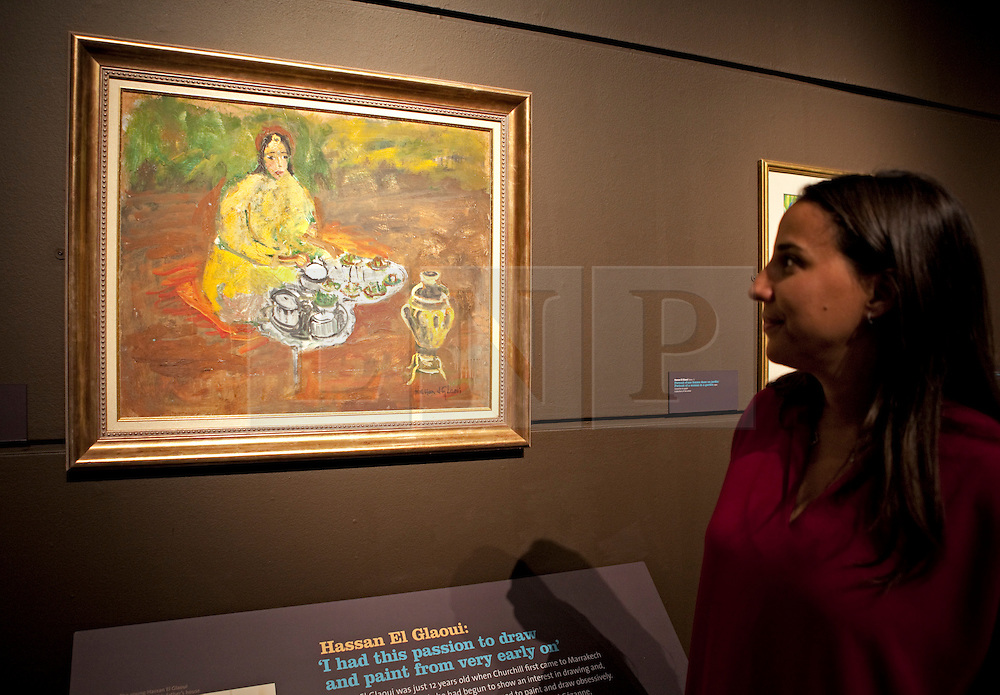 © Licensed to London News Pictures. 19/01/2012. London, U.K..Preview of exhibition Meetings in Marrakech: the paintings of Hassan El Glaoui and Winston Churchill. The exhibition runs between 20 January – 31 March. It is the first time the paintings of Winston Churchill have been exhibited with another artist Leighton House Museum. Painting by Hassan El Glaoui, titled 'Ceremonie du the' , 1940-45..Photo credit : Rich Bowen/LNP