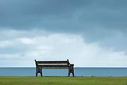 Empty bench seat and grey sky, Isle of Arran, Scotland