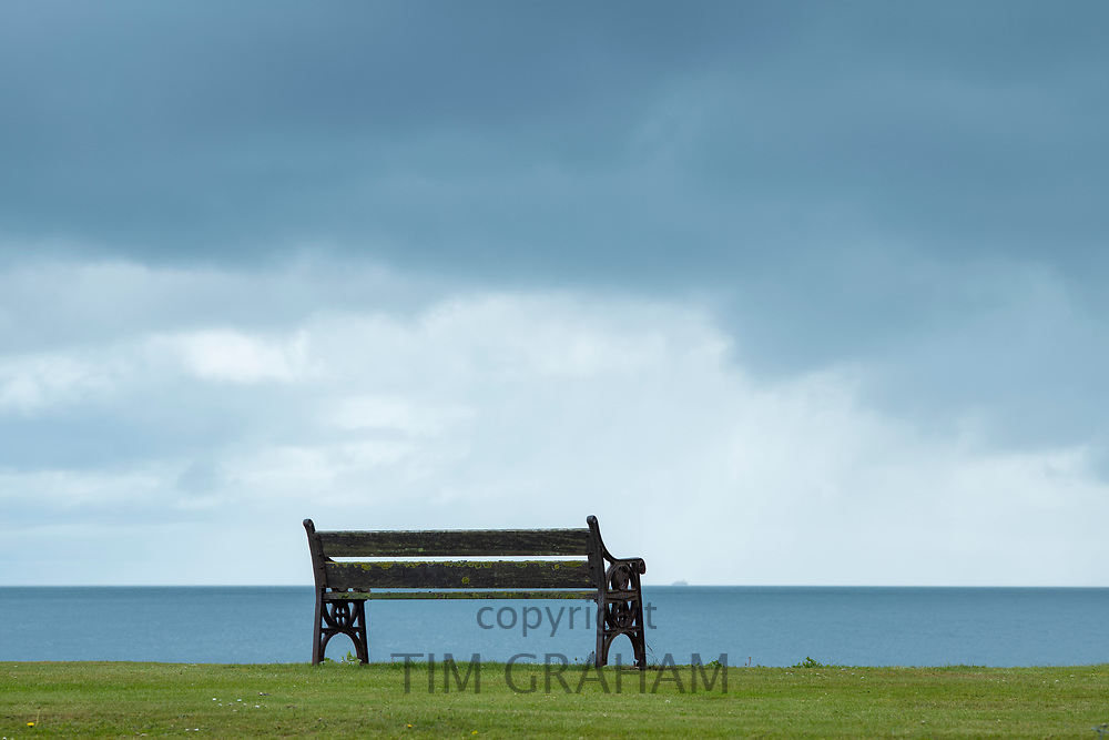 Empty bench seat and grey sky, Isle of Arran, Scotland