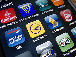 detail of many travel and airline apps on a iPhone 5 smart phone
