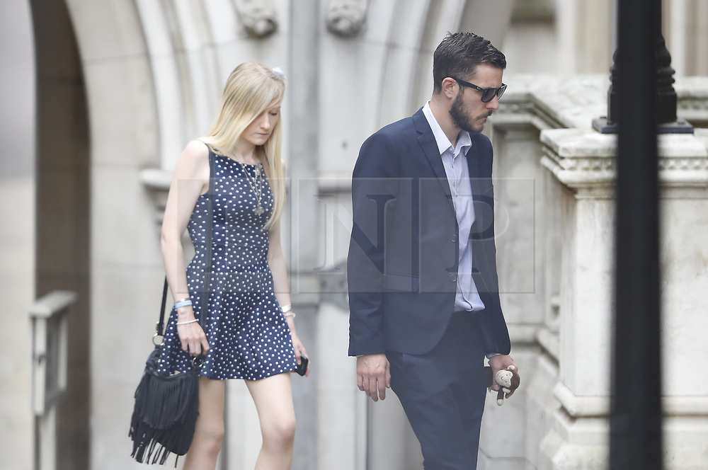 © Licensed to London News Pictures. 10/07/2017. London, UK. Connie Yates and <br /> Chris Gard arrive at The High Court. The parents of terminally ill Charlie Gard have returned to the High Court in light of new evidence relating to potential treatment for their son's condition. An earlier lengthy legal battle ruled that Charlie could not be taken to the US for experimental treatment. London, UK. Photo credit: Peter Macdiarmid/LNP