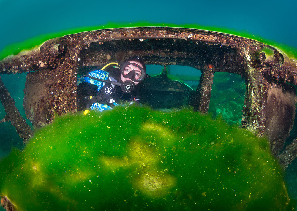 Scuba diver in the cockpit of Sessna Aircraft at Dutch Springs, Bethlehem