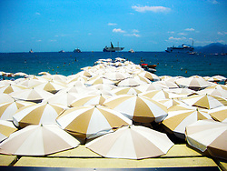 Umbrellas cover the Beach Restaurant at The InterContinental Carlton, the luxury hotel built in 1909, located at 58 La Croisette in Cannes on the French Riviera. 3rd July, 2011..©Pic : Michael Schofield.