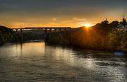 Train on the bridge over the Rhein in Eglisau, Switzerland at sunset.