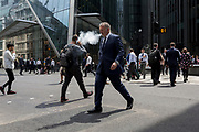 City workers cross Leadenhall in the City of London, the capital's financial district (aka the Square Mile), on 10th July 2019, in London England.