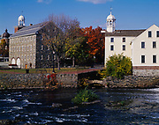 Wilkinson Mill, built in 1810, and Old Slater Mill, built in 1793, with the Seekonk River, Pawtucket, Rhode Island.