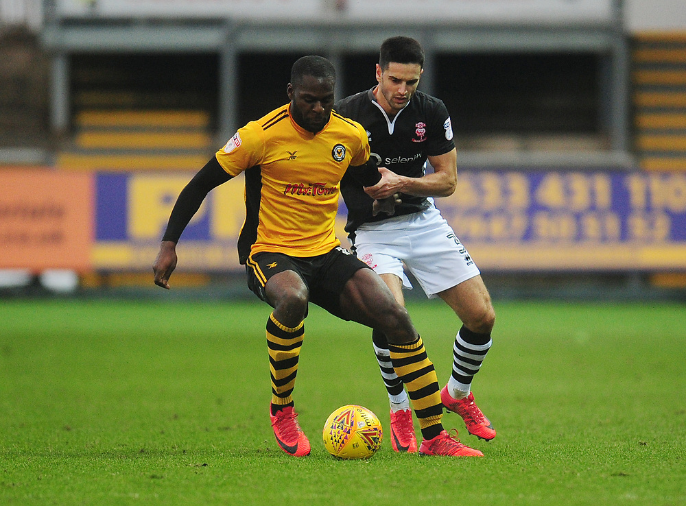 Newport County's Frank Nouble under pressure from Lincoln City's Sam Habergham<br /> <br /> Photographer Kevin Barnes/CameraSport<br /> <br /> The EFL Sky Bet League Two - Newport County v Lincoln City - Saturday 23rd December 2017 - Rodney Parade - Newport<br /> <br /> World Copyright © 2017 CameraSport. All rights reserved. 43 Linden Ave. Countesthorpe. Leicester. England. LE8 5PG - Tel: +44 (0) 116 277 4147 - admin@camerasport.com - www.camerasport.com