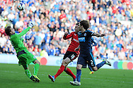 Cardiff city's Jordon Mutch goes close to scoring but his close range shot is saved by Newcastle keeper Tim Krul. .Barclays Premier League match, Cardiff city v Newcastle Utd  at the Cardiff city stadium in Cardiff, South Wales on Saturday 5th Oct 2013. pic by Andrew Orchard, Andrew Orchard sports photography,