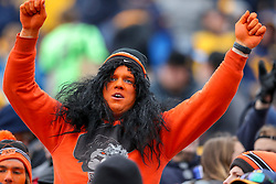 Nov 23, 2019; Morgantown, WV, USA; An Oklahoma State Cowboys fan cheers during the second quarter against the West Virginia Mountaineers at Mountaineer Field at Milan Puskar Stadium. Mandatory Credit: Ben Queen-USA TODAY Sports