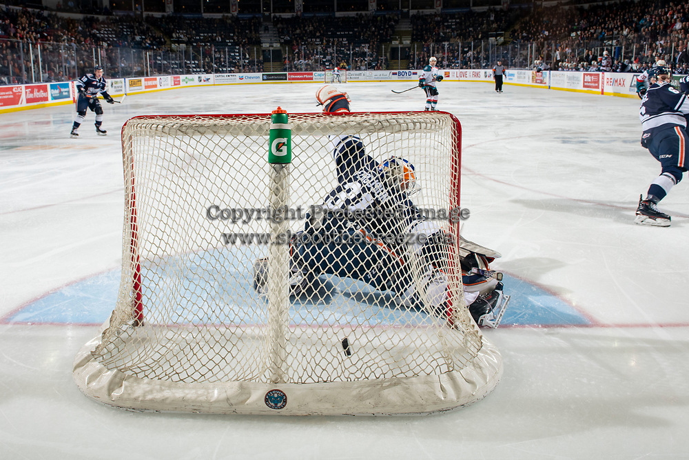 KELOWNA, CANADA - FEBRUARY 2: Dylan Ferguson #31 of the Kamloops Blazers misses a third period save on a shot by Trevor Wong #14 of the Kelowna Rockets, scoring his first WHL career goal on February 2, 2019 at Prospera Place in Kelowna, British Columbia, Canada.  (Photo by Marissa Baecker/Shoot the Breeze)