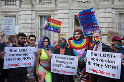 Campaigners against LGBT+ conversion therapy, including Jayne Ozanne of the Ban Conversion Therapy Coalition (c) and veteran LGBT+ and human rights campaigner Peter Tatchell (r), attend a picket outside the Cabinet Office and Government Equalities Office on 23rd June 2021 in London, United Kingdom. They also handed in a petition signed by 7,500 people calling on the government to fulfil its promise made in July 2018 to ban the practice. LGBT+ conversion treatments, which have been linked to anxiety, depression and self-harm, have been condemned by major UK medical, psychological and counselling organisations.