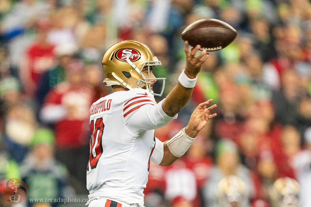 December 29, 2019; Seattle, Washington, USA; San Francisco 49ers quarterback Jimmy Garoppolo (10) during the first quarter against the Seattle Seahawks at CenturyLink Field.