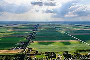 Nederland, Groningen, Gemeente Stadskanaal, 05-08-2014; Eerste Exloermond (1e Exloermond), dorp langs de vaart die uitmond in Het Musselkanaal, veenkoloniaal kanaal, gegraven voor de ontginning van het hoogveen.<br /> Village along a peat canal dug for the reclamation of the bog.<br /> luchtfoto (toeslag op standard tarieven);<br /> aerial photo (additional fee required);<br /> copyright foto/photo Siebe Swart