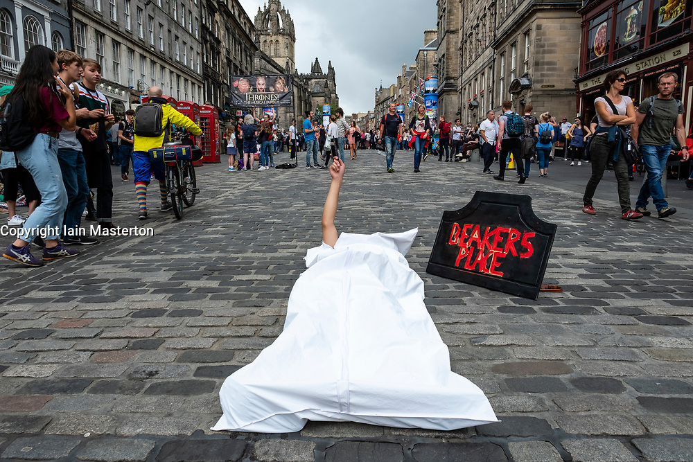 Edinburgh, Scotland, UK; 2 August, 2018. On day before official opening of the Edinburgh Festival Fringe 2018, performers are active on the Royal Mile handing out fliers and meeting the public. Pictured; Performer for  Beaker's Place production by Only Lucky Dogs Theatre Company.