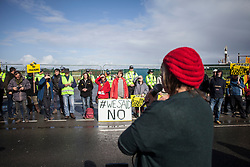 © Licensed to London News Pictures. 29/09/2017. Lancashire, UK.  An activist addresses a crowd of protesters outside Cuadrillas Hydraulic Fracturing site on Preston New Road, Lancashire. Over 100 protesters from all over the UK joined the on going anti-fracking protest on Preston New Road in Lancashire ahead of the Conservative Party Conference in Manchester. Photo credit: Steven Speed/LNP