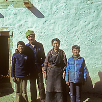 Kancha Sherpa and his wife Ang Lakpa pose with their sons outside their house in Namche Bazaar, a leading town for the Sherpa people.