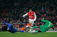 Photo: Tom Dulat/Sportsbeat Images.<br /> <br /> Arsenal v Steaua Bucharest. UEFA Champions League. 12/12/2007.<br /> <br /> Ifeanyi Emeghara of Steaua Bucharest tries to stop Theo Walcott of Arsenal. Goalkeeper of Steaua Bucharest Robinson Zapata saves the ball.