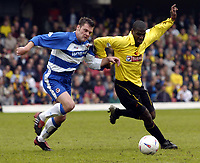 Photo: Richard Lane.<br /> Watford v Reading. Nationwide Division One. 09/05/2004.<br /> Bruce Dyer is challenged by Graeme Murty.