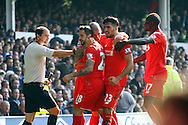 Danny Ings of Liverpool celebrates with his teammates after scoring his teams 1st goal. Barclays Premier League match, Everton v Liverpool at Goodison Park in Liverpool on Sunday 4th October 2015.<br /> pic by Chris Stading, Andrew Orchard sports photography.