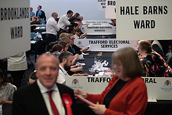 © Licensed to London News Pictures . 03/05/2018. Trafford, UK. Ballots are counted at the Trafford Council count at The Point at Lancashire County Cricket Club . The Labour Party are looking to overturn the Conservative Party's majority on the council . Local council elections are taking place across the country . Photo credit : Joel Goodman/LNP