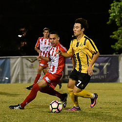 BRISBANE, AUSTRALIA - APRIL 13: Kyusub Bang of Moreton Bay controls the ball under pressure from Linden Farr of Olympic FC during the NPL Queensland Senior Men's Round 4 match between Olympic FC and Moreton Bay Jets at Goodwin Park on April 13, 2017 in Brisbane, Australia. (Photo by Patrick Kearney/Olympic FC)