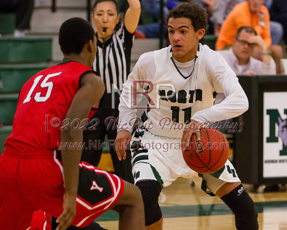 #11 Trae Young begins his drive past the Miller defense.