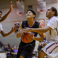 Miyamura Patriot Darin Baca (21) charges past Gallup Bengals Troy Etistty (42) and Zakarri Fields (22) Friday at Gallup High School.