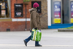 © Licensed to London News Pictures. 20/05/2021. London, UK. A man wearing a face mask walks along Hounslow High Street, West London. Hounslow is the first London borough to actively test for the Indian Covid variant B.1.617.2. Photo credit: Ray Tang/LNP