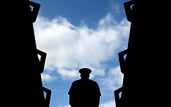 A member of the armed forces stands in an entrance way to a court on day eight of the Wimbledon Championships at the All England Lawn Tennis and Croquet Club, Wimbledon.