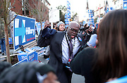 A supporter leads a group in a chant for Democratic presidential candidate Hillary Clinton during a rally outside the Gaillard Center where the Democratic are holding their debates, on Sunday, Jan. 17, 2016, in Charleston, S.C. (AP Photo/Stephen B. Morton)