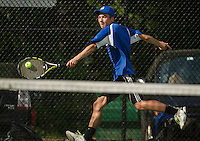 Gilford's Grant Workman makes a return shot on Bow's Brayden Binder during singles boys tennis Tuesday afternoon.  (Karen Bobotas/for the Laconia Daily Sun)