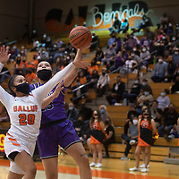 Miyamura Patriot Destiny Bryan (23) drives to the basket for a layup as Gallup Bengal Savannah Watson (20) defends during their varsity basketball game at Gallup High School in Gallup Friday.