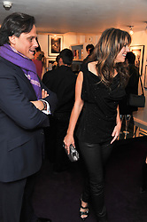 ARUN NAYER and ELIZABETH HURLEY at a private view of photographs by Anthony Souza held at The Little Black Gallery, 13A Park Walk, London SW10 on 13th December 2011.