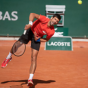 PARIS, FRANCE September 26.  Novak Djokovic of Serbia  during a practice match against Dominic Thiem of Austria on Court Philippe-Chatrier in preparation for the 2020 French Open Tennis Tournament at Roland Garros on September 26th 2020 in Paris, France. (Photo by Tim Clayton/Corbis via Getty Images)