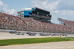 August 12, 2018 - Brooklyn, MI, U.S. - BROOKLYN, MI - AUGUST 12: Monster Energy NASCAR Cup Series driver Denny Hamlin (11) leads the field on lap one during the Monster Energy NASCAR Cup Series Consumers Energy 400 at Michigan International Speedway on August 12, 2018 in Brooklyn, Michigan.(Photo by Adam Lacy/Icon Sportswire) (Credit Image: © Adam Lacy/Icon SMI via ZUMA Press)