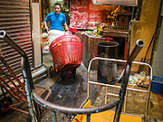 03 FEBRUARY 2015 - BANGKOK, THAILAND: A porter pushes his handtruck through a Soi (alley) in the Chinatown section of Bangkok. After months of relative calm following the May 2014 coup, tensions are increasing in Bangkok. The military backed junta has threatened to crack down on anyone who opposes the government. Relations with the United States have deteriorated after Daniel Russel, the US Assistant Secretary of State for Asian and Pacific Affairs, said that normalization of relations between Thailand and the US would depend on the restoration of a credible democratically elected government in Thailand.        PHOTO BY JACK KURTZ
