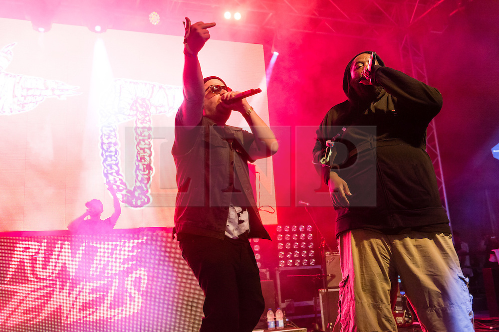 © Licensed to London News Pictures. 06/06/2015. London, UK.   Run the Jewels performing live at Field Day Festival Saturday Day 1.   In this picture - El-P (left), Killer Mike (right).  Run the Jewels is an American hip hop duo composed of  rapper/music producer El-P and rapper Killer Mike.  Photo credit : Richard Isaac/LNP
