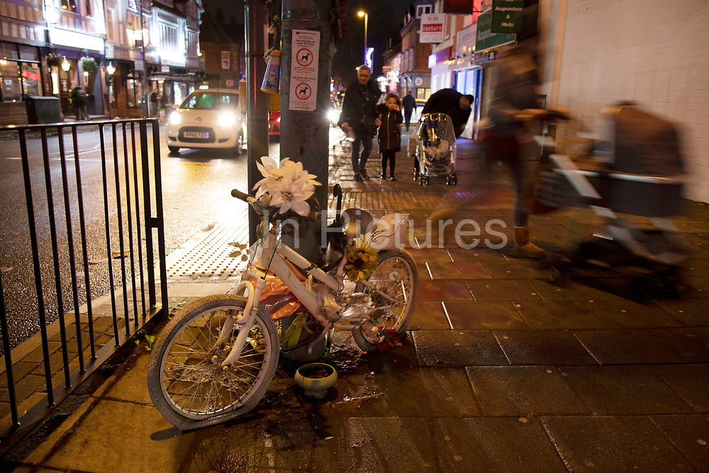 A young childs ghost bike at night in the Kings Heath area of Birmingham, United Kingdom. A ghost bike or ghostcycle is a bicycle set up as a roadside memorial in a place where a cyclist has been killed or severely injured usually by a motor vehicle. Apart from being a memorial, it is usually intended as a reminder to passing motorists to share the road. Ghost bikes are usually junk bicycles painted white, sometimes with a placard attached, and locked to a suitable object close to the scene of the accident. Many of these memorials are political statements erected by individuals who aim to make a wider point beyond personal loss regarding general road cyclist awareness.