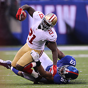 Frank Gore, San Francisco 49ers, is tackled by Devon Kennard, New York Giants, during the New York Giants V San Francisco 49ers, NFL American Football match at MetLife Stadium, East Rutherford, NJ, USA. 16th November 2014. Photo Tim Clayton