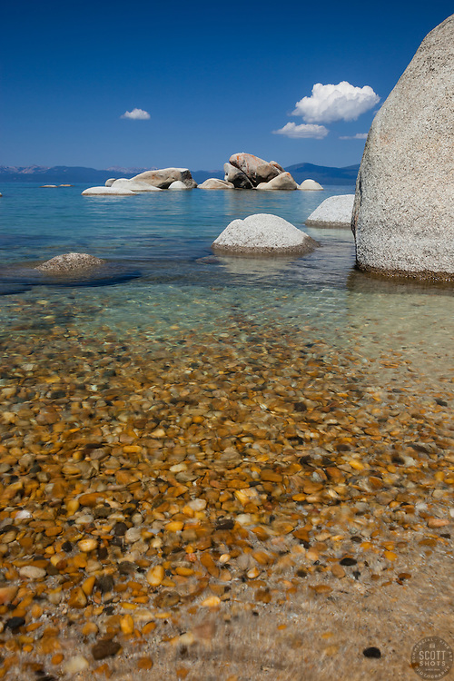 """""""Pebbles at Whale Beach 3"""" - These pebbles were photographed along the shore of Whale Beach on the East shore of Lake Tahoe. Whale Rock can be seen in the distance."""