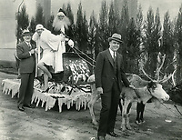 1928 The genesis of Hollywood's famous Santa Claus Lane Parade was the idea of the Hollywood's Merchants Assoc. The first sleigh and reindeer to go down Hollywood Blvd. took place in 1928 when actress, Jeanette Loff joined Santa Claus in the Sleigh. This publicity photo shows actress, Lili Damita, posing with Col. Harry Baine. She was scheduled to accompany Santa on the inaugural ride but, for some reason, Jeanette Loff took her place.