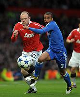 Old Trafford Manchester United v Chelsea Champions League Quarter Final second leg 12/04/2011<br />Wayne Rooney (Manchester United) Ashley Cole  (Chelsea)<br />Photo: Robin Parker Fotosports International