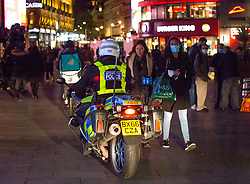 Licensed to London News Pictures. 24/09/2020. London, UK. Police officers patrol the streets of Soho in central London on the first day of the 10PM curfew comes into force. Prime Minister Boris Johnson has announced new measures to attempt to reduce the rising number of new Covid-19 infections. Photo credit: Marcin Nowak/LNP